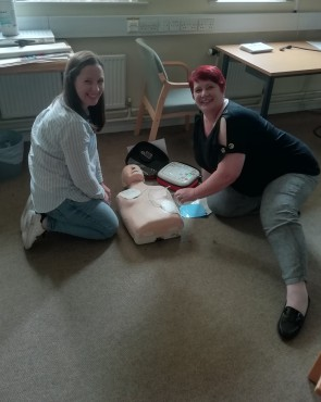 DaCE training for PAs in Cumbria. In this photograph two women are practicing their resuscitation skills using a dummy.