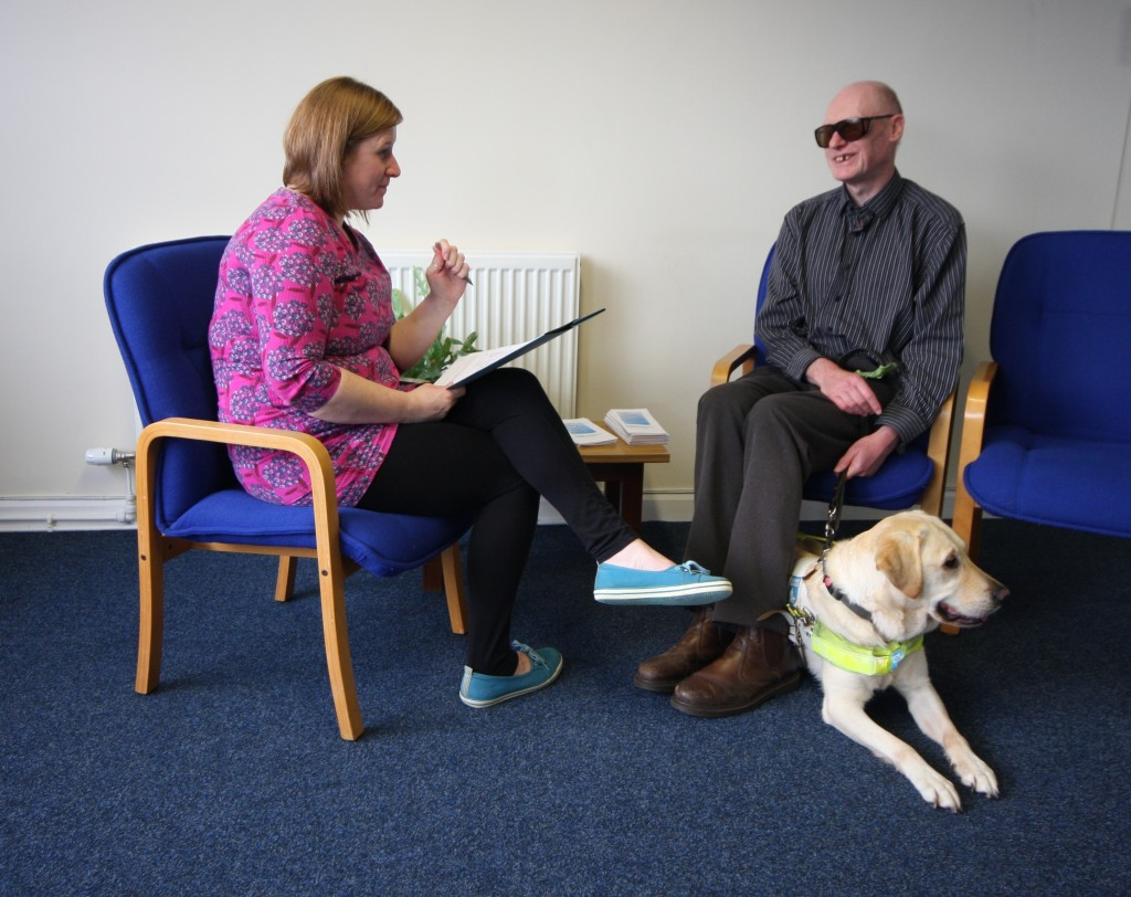 Photography of DaCE Cumbria staff member talking to a client. #Disability #Cumbria #Charity #DaCE Cumbria