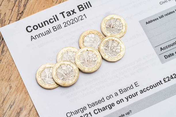 Photograph of a Council Tax bill and coins.