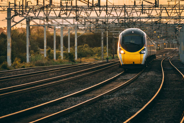 Photograph of a train travelling along a railway track.